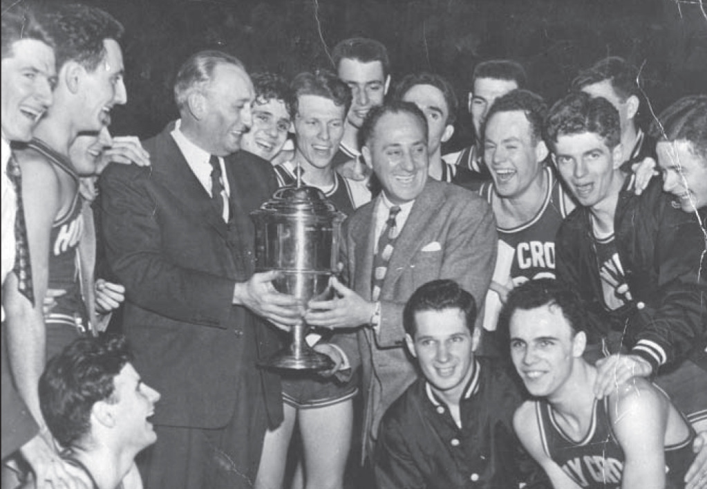 Holy Cross Coach Alvin 'Doggie' Julian and his champions
